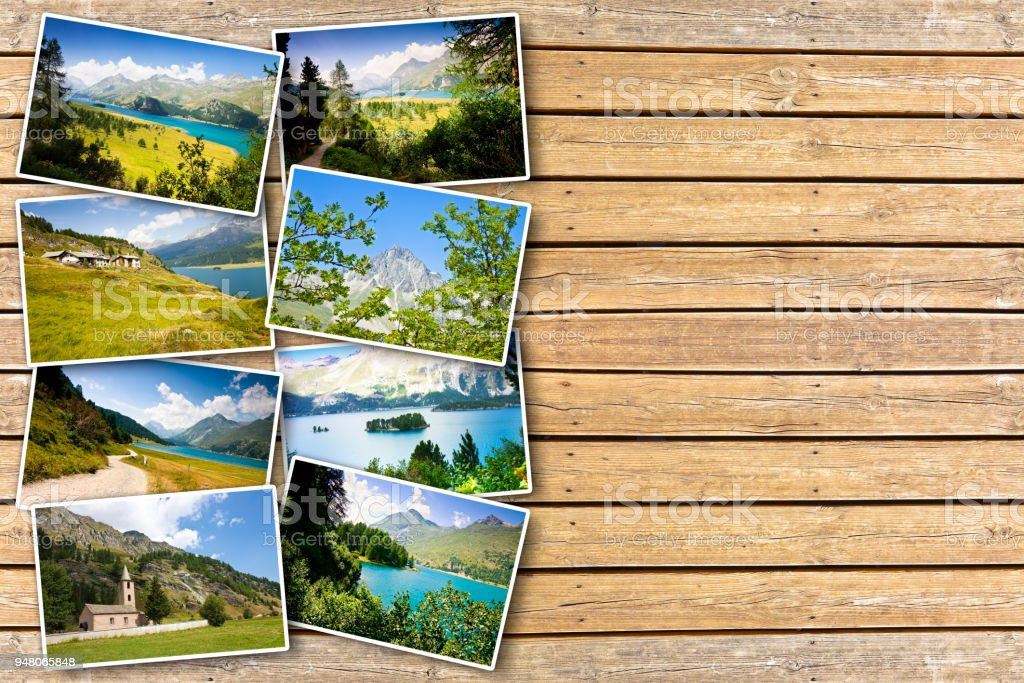 Sils lake in the Upper Engadine Valley in a summer day (Europe - Switzerland) - Postards concept on wooden background stock photo