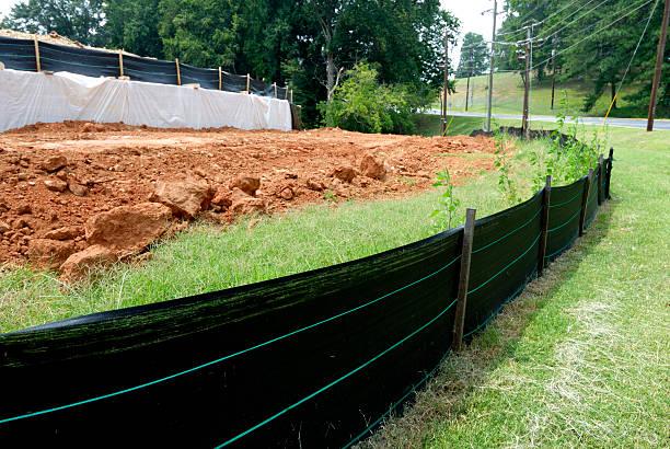 silt fence erosion control at construction site - geërodeerd stockfoto's en -beelden