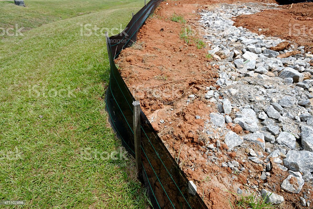 Silt fence erosion control barrier at construction site royalty-free stock photo