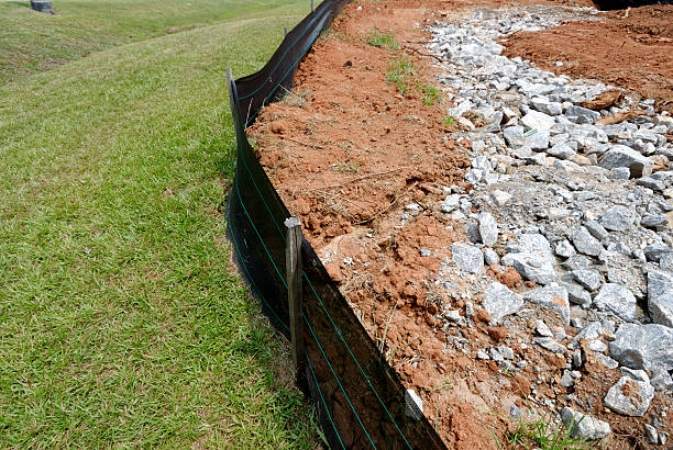 Silt fence erosion control barrier at construction site stock photo