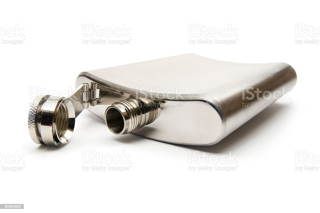 A silver alcohol decanter lying on its side with the lid off stock photo