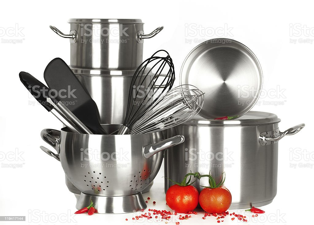 Silver and black kitchen utensils colander and tomatoes stock photo
