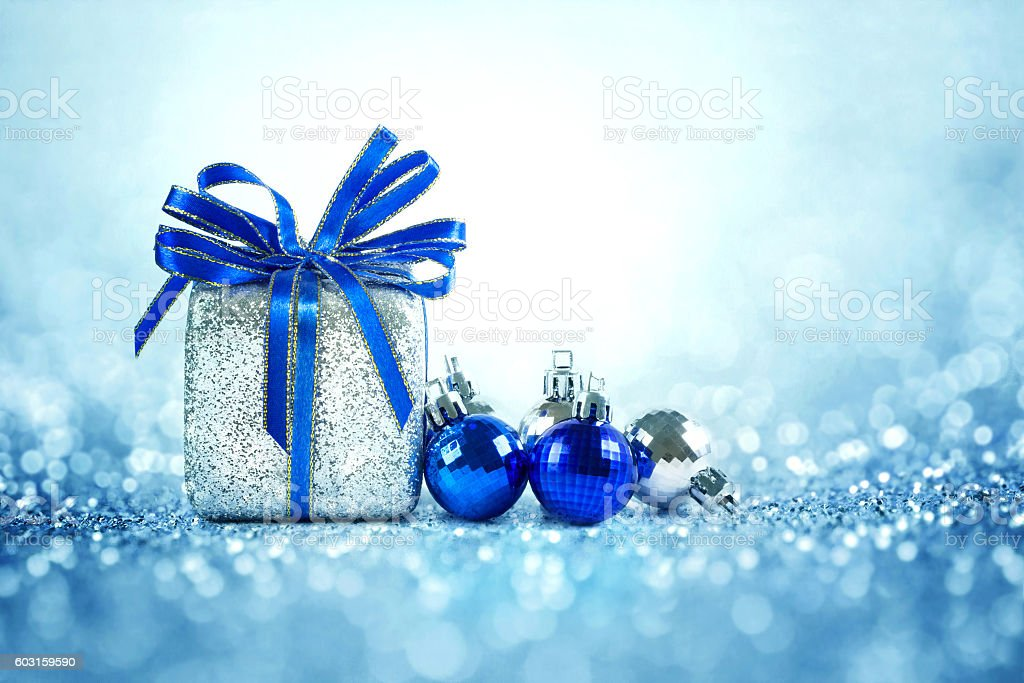 Silver and blue Christmas balls and gifts стоковое фото