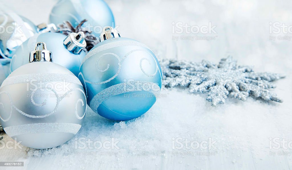 Silver and Blue Christmas Balls with Sparkle and Snow stock photo