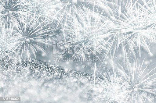 636207118 istock photo Silver and blue fireworks at New Year 623748974