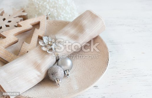 istock Silver and cream Christmas Table Setting 499654926