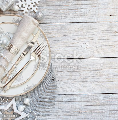 istock Silver and cream Christmas Table Setting 607920806