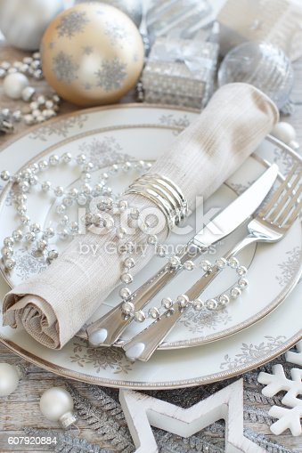 istock Silver and cream Christmas Table Setting 607920884
