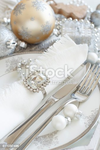 istock Silver and cream Christmas Table Setting 611092496