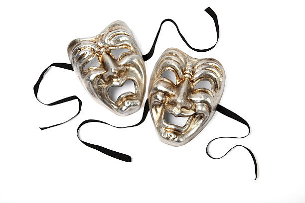 Silver and gold Comedy and Tragedy theater masks on white stock photo