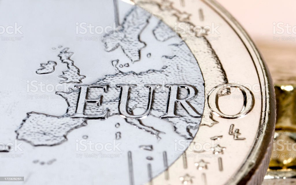 Silver and gold euro coin with Europe embossed stock photo