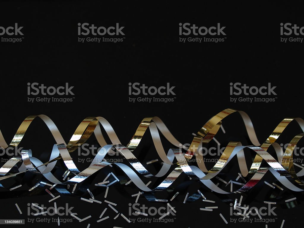Silver and Gold Streamers on Black stock photo