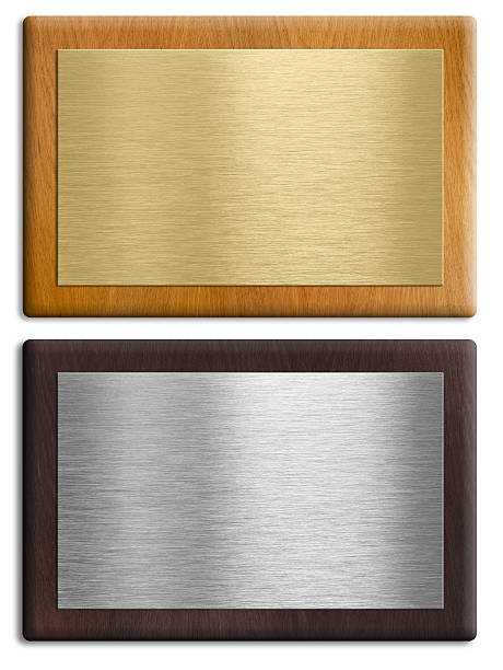 Silver and gold wooden plaques isolated on white stock photo