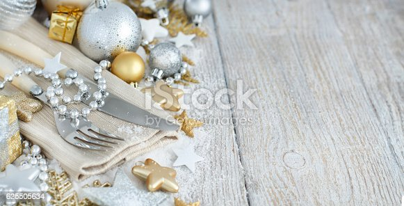 istock Silver and golden Christmas Table Setting 625505634