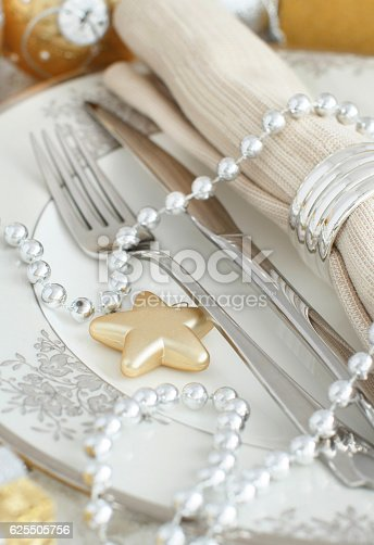 istock Silver and golden Christmas Table Setting 625505756