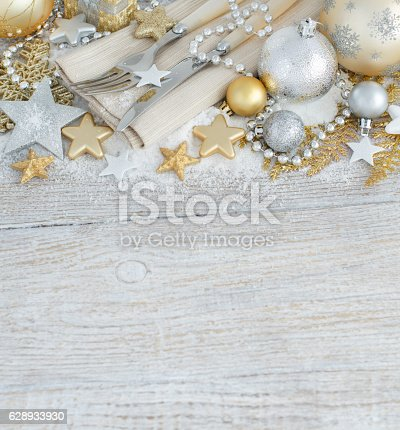 istock Silver and golden Christmas Table Setting 628933930