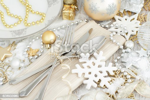 istock Silver and golden Christmas Table Setting 628933980