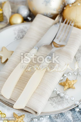 istock Silver and golden Christmas Table Setting 629778592
