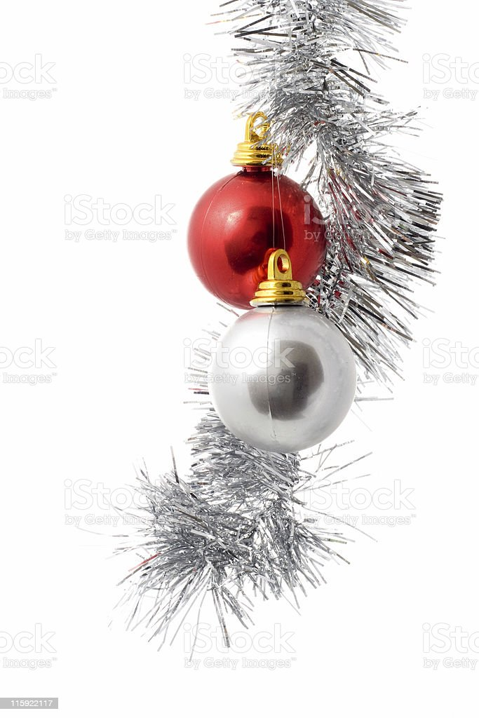 Silver and red ornament hanging from Christmas twine stock photo