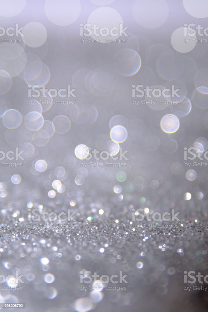 Silver and white bokeh lights defocused. abstract background стоковое фото