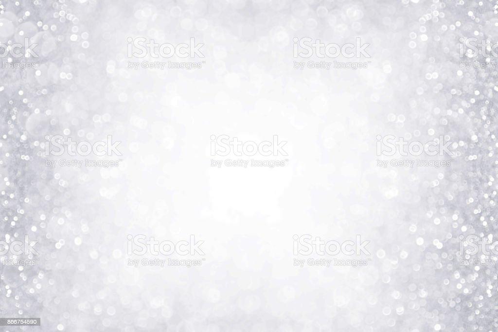 Elegant silver and white glitter sparkle confetti background border...