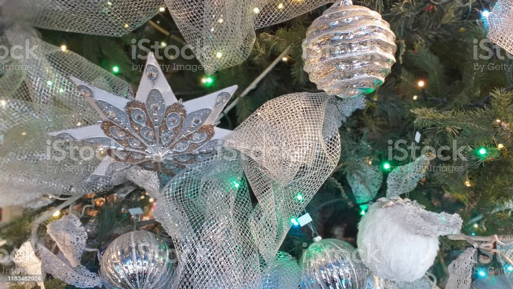 Silver And White Glitter Christmas Tree Ornaments Such As Balls Star And Ribbons Stock Photo Download Image Now Istock