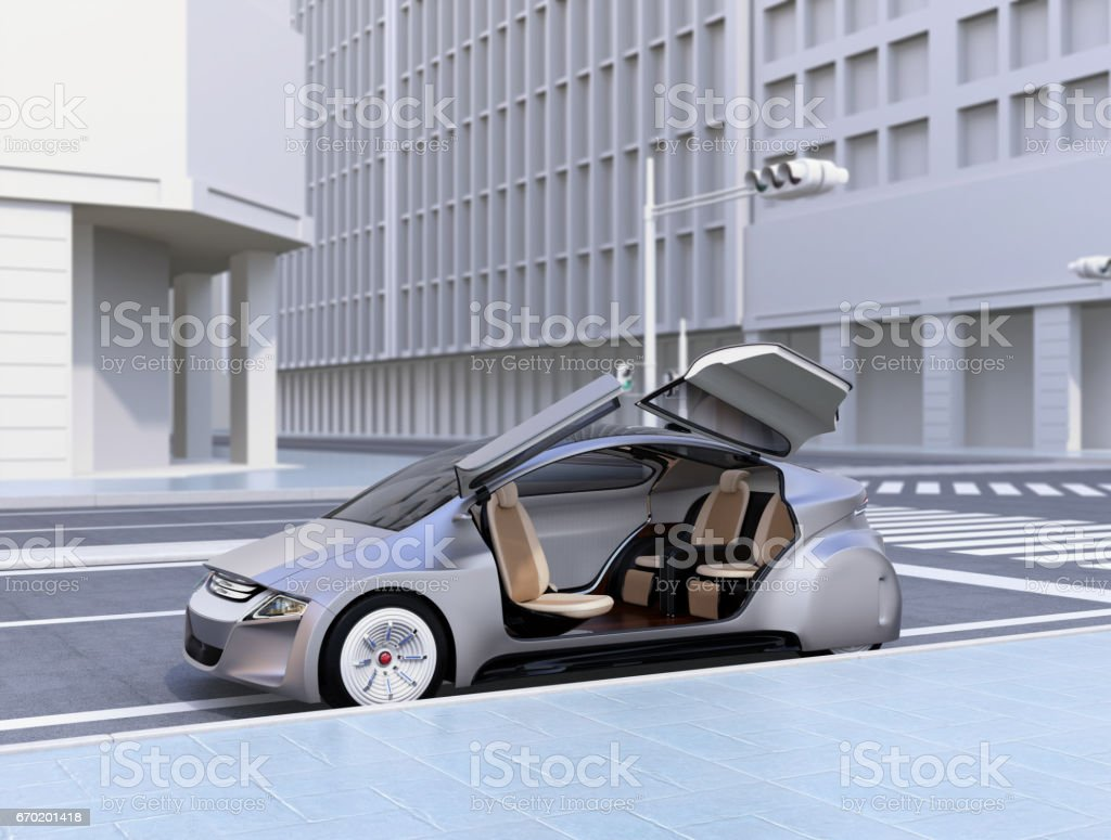 Silver autonomous car parking at the side of the road stock photo