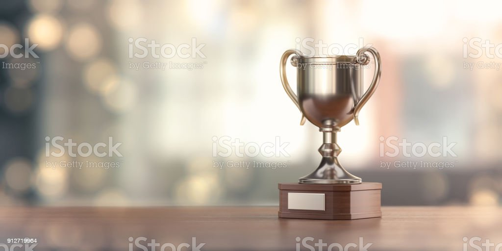 Silver Award Cup Against Defocused Background stock photo