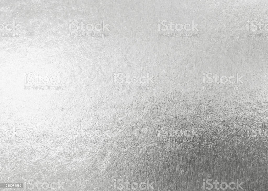 Silver background metallic texture wrapping foil paper shiny white grey metal backdrop for wall paper decoration element stock photo