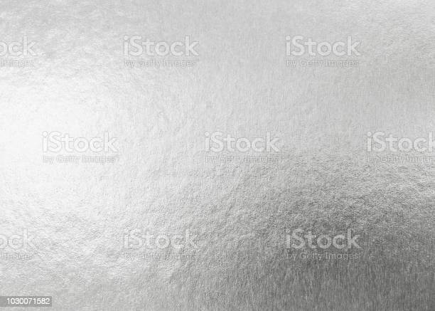 Photo of Silver background metallic texture wrapping foil paper shiny white grey metal backdrop for wall paper decoration element