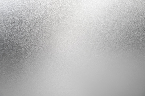 istock Silver background white texture light color foil glitter sparkle shiny metal wall dust paper luxury elegant abstract concept bright cardboard backdrop pattern 963093176