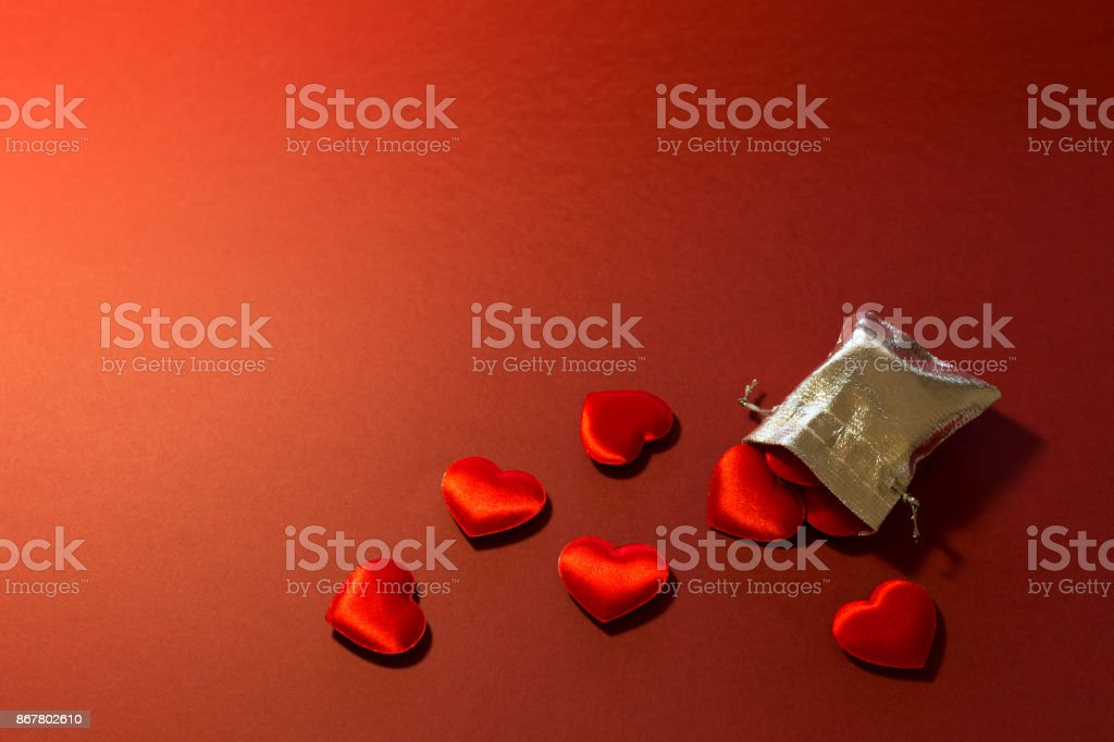 Silver bag filled with love and romance stock photo
