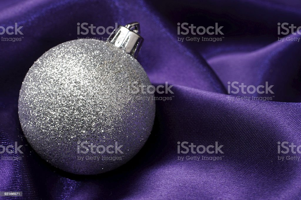 silver bauble on purple cloth royalty-free stock photo