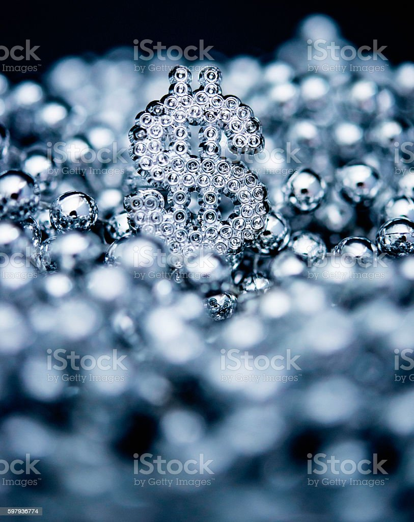 Silver beads with silver dollar sign in center stock photo
