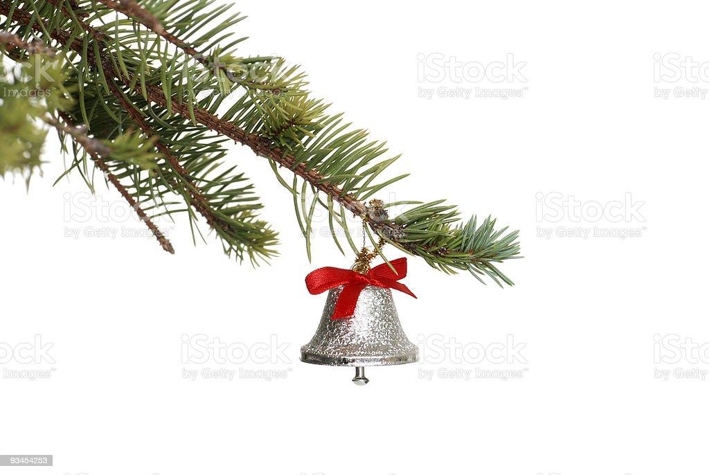 silver bell auf einem spruce tree branch Lizenzfreies stock-foto