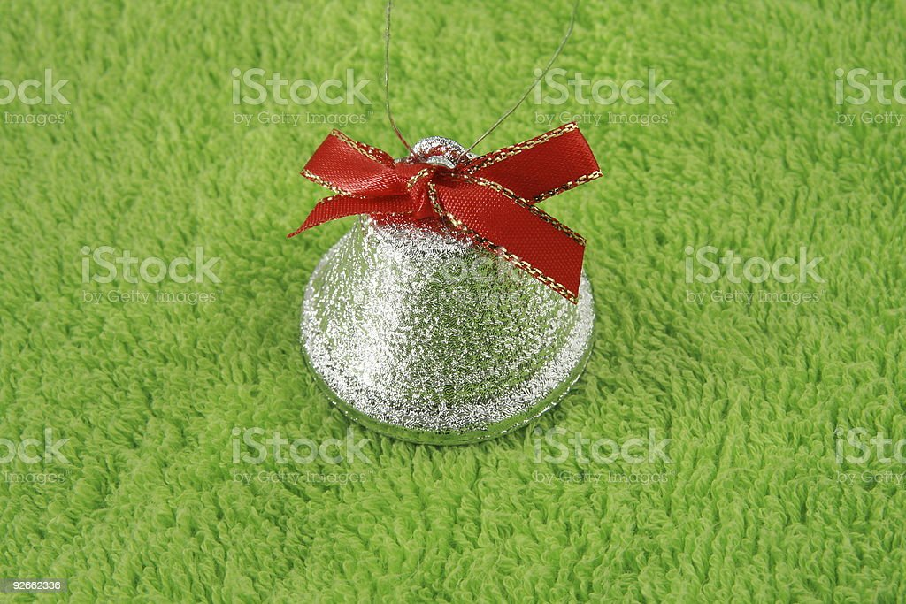 Silver bell on green royalty-free stock photo