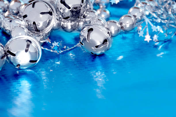Silver bells on blue stock photo