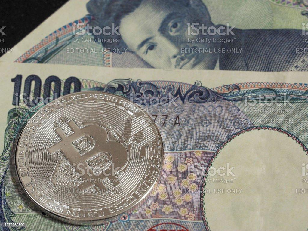 Silver Bitcoin on Japanese 1,000 yen stock photo
