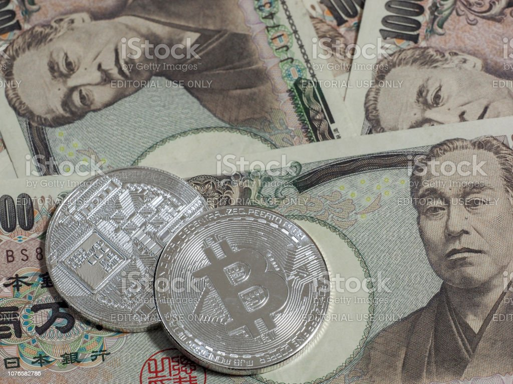 Silver Bitcoins on Japanese 10,000 yen stock photo