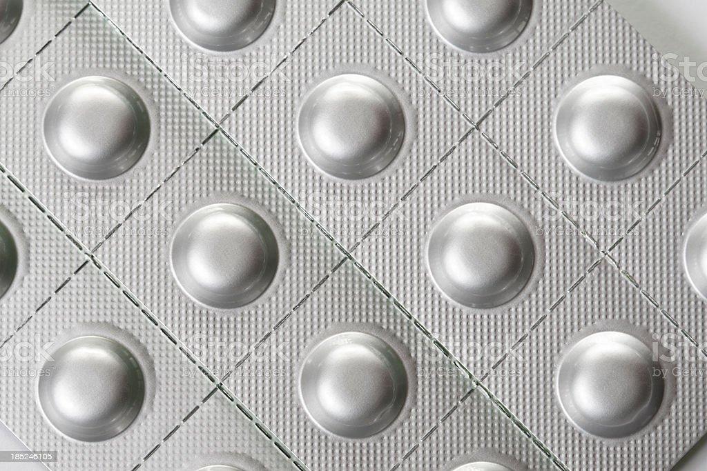 Silver blister packs of pills stock photo