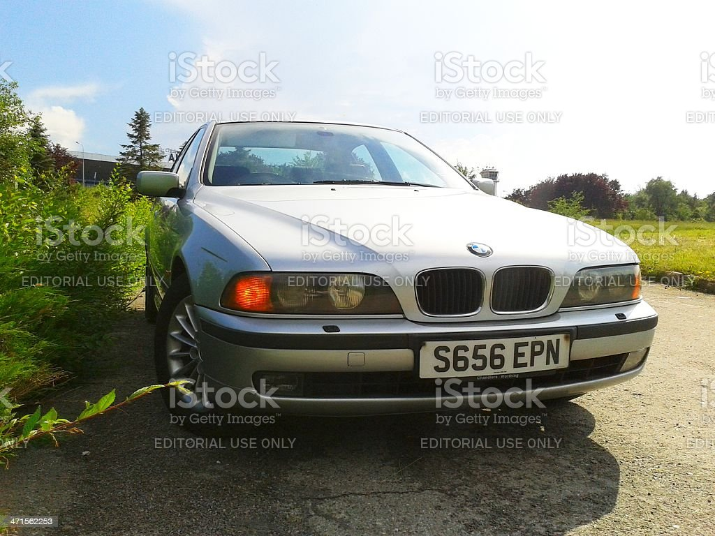Silver BMW on the roadside stock photo