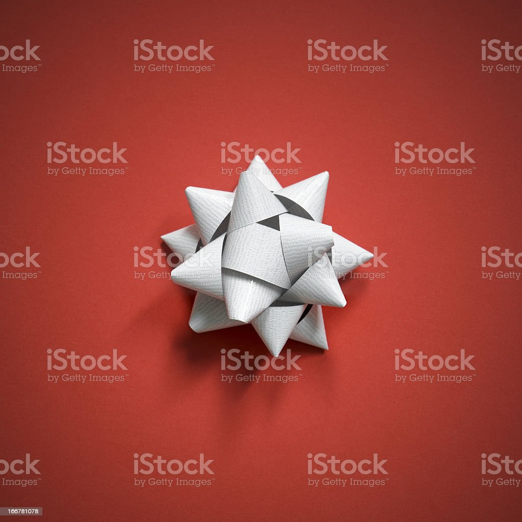 Silver bow on christmas red background stock photo