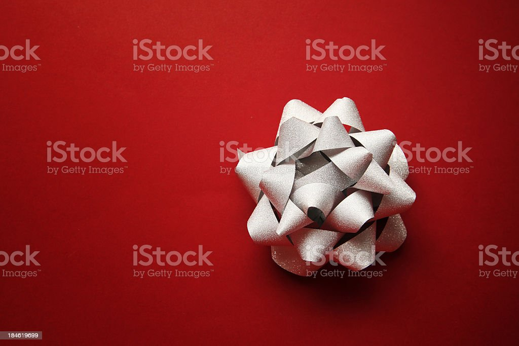 Silver bow on red royalty-free stock photo
