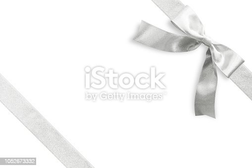 Silver bow satin ribbon band stripe fabric on corner (isolated on white background with clipping path) for Christmas holiday gift box present wrap design decoration ornament element