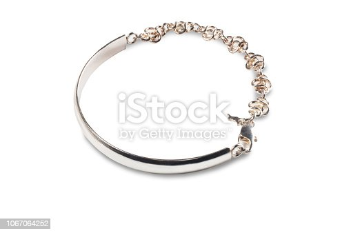 Studio image of a silver bracelet isolated on a white background.