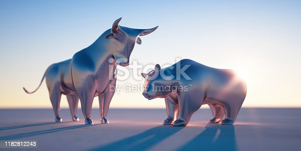 Golden Bull and Bear against a bright blue Sky in the Evening Sun