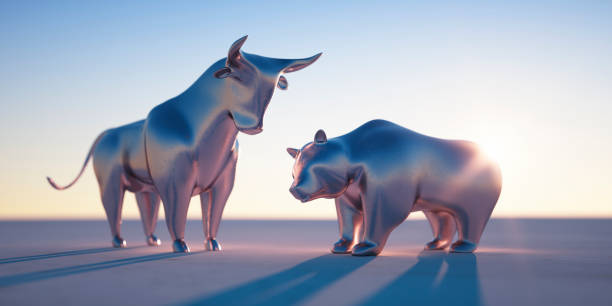 Silver Bull and Bear in Evening Sun Golden Bull and Bear against a bright blue Sky in the Evening Sun bull market stock pictures, royalty-free photos & images