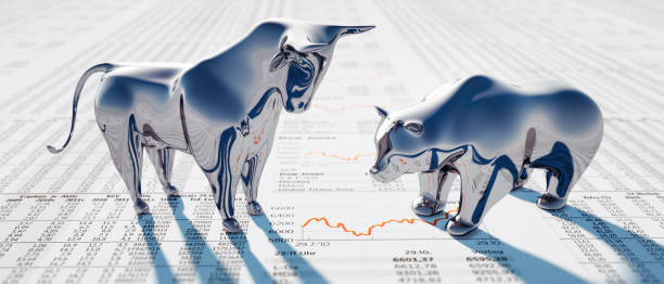Silver Bull and Bear on Newspaper Silver Bull and Bear standing on a financial Newspaper with Charts bull market stock pictures, royalty-free photos & images