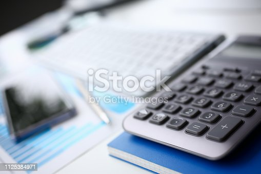 istock Silver calculator and financial statistics on clipboard 1125384971