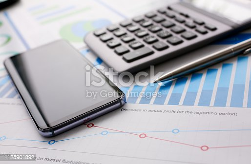 istock Silver calculator with gray keyboard is lying 1125901892